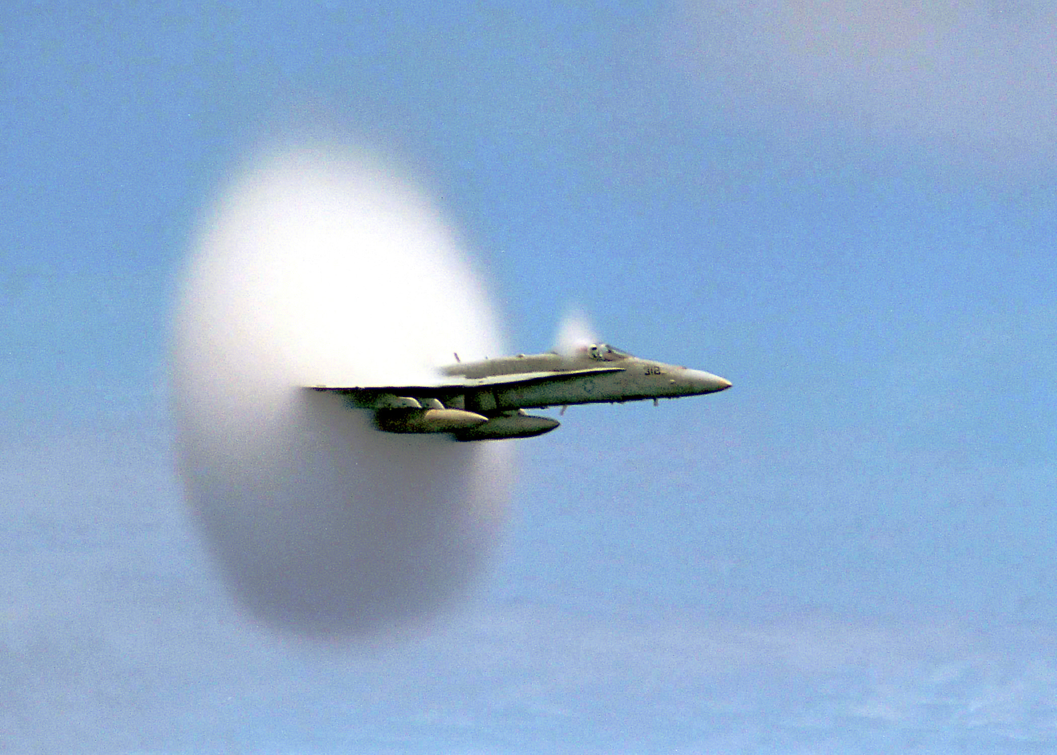 "990707-N-6483G-001 ABOARD USS CONSTELLATION (July 7, 1999)-- Lieutenant Ron Candiloro, assigned to Fighter Squadron One Five One (VF-151), breaks the sound barrier in an F/A-18 ""Hornet"". VF-151 is currently deployed with the USS Constellation (CV 64) battlegroup.  U.S. Navy photo by Ensign John Gay.  (RELEASED)"